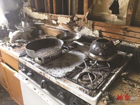 图为烧焦的灶台厨具。